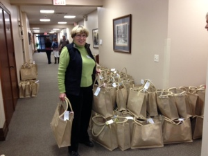 Jane Guisinger, layette chairwoman with layettes ready for delivery